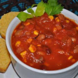 Corn Chili Recipe - Corn, stewed tomatoes, pinto and kidney beans are heated together with a bit of cayenne and tomato sauce in this quick meal.