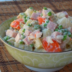 Potato Ham Salad Recipe - Using ranch dressing as the base for this salad with potatoes, carrots, peas, pickles, onion, and ham makes for a fantastic twist to traditional potato salad.