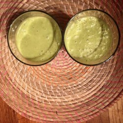 Moringa Coconut Smoothie Recipe - This moringa coconut smoothie, made with bananas, peaches, and almond butter, is a great on-the-go breakfast that will keep you going until lunch.