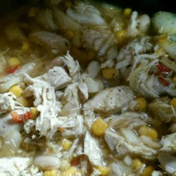 Award Winning Chicken Chili Recipe - Letting the chicken, beans, and hominy rest overnight before simmering for hours in a slow cooker brings out all the flavors in this white chili.