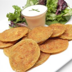 Barb's Fried Green Tomatoes with Zesty Sauce Recipe - Dip these buttery, golden fried green tomatoes in a cool and spicy sauce for a delicious and easy appetizer.