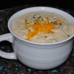 Baked Potato Soup IV Recipe - This is a hearty potato soup that tastes like a creamy baked potato. I invented it to please a picky vegetarian daughter who pronounced it 'delicious'. Garnish with chives, shredded cheese or dried dill. Serve with a bread (flour tortillas, pita bread, sourdough or cornbread) and a salad or fruit.