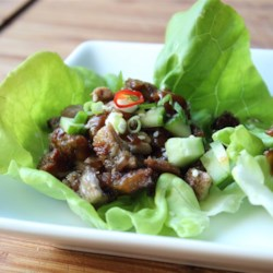 "Easy ""Peking Duck"" Lettuce Cups Recipe - Slowly roasted duck leg meat is chopped, fried up in duck fat until crispy, then served in lettuce cups with chopped cucumber, green onions, and sesame seeds."