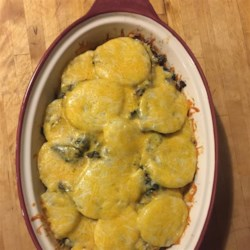 Curry Kale and Potato Galette Recipe - Layers of thinly sliced potatoes and curried kale are baked together, creating a buttery galette you can slice and serve for any meal of the day.