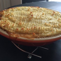 Proper English Cottage Pie Recipe - For this savory pie, ground beef, onions, veggies, herbs and spices marry perfectly: Everything is sauteed together and then combined with broth and tomato paste, and simmered until ready to pour into a prepared pie crust. The hearty filling is then topped with fluffy mashed potatoes, sprinkled with Cheddar cheese, and baked.