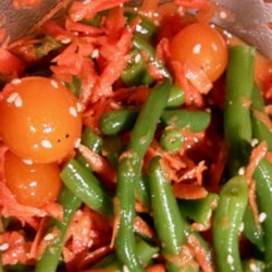Crisp Green Bean Salad Recipe - This quick and simple salad of green beans, tomatoes, and carrots is tossed with a homemade, Asian-influenced dressing.