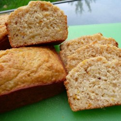 Pineapple Tangerine Bread Recipe - The rich sweetness of pineapple is complemented with the bite of tangerine zest in this quick bread.  Wheat germ imparts a nutty flavor.