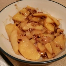 Toffee and Cinnamon Apples Recipe - Cooked apples and cream spiced with cinnamon, speckled with pecans and streaked with caramel.