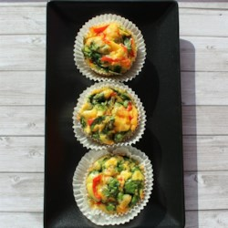 Skinny Girl Individual Omelets Recipe - Omelets made in a muffin tin with egg substitute, spinach, and Cheddar cheese are a skinny, grab-and-go breakfast the whole family will love.