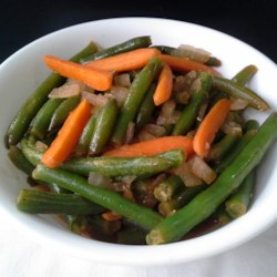 Egyptian Green Beans with Carrots Recipe - Green beans and carrots are simmered in a cardamom-scented broth creating an Egyptian-inspired side dish the whole family will enjoy.