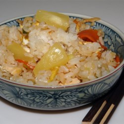 Pineapple Fried Rice Recipe - We like this one. The rice is cooked in pineapple juice. A very good beginning. And then its added to a wok-full of tofu, mushrooms, soy sauce, green onions and carrots. Garnish with crushed pineapple and strips of cooked egg. Yumm!