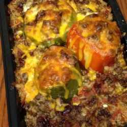 Yummy Stuffed Peppers Recipe - Combining several recipes led to the invention of this delicious stuffed pepper dish that fills each pepper with a mixture of rice, cheese, beef, and spices.