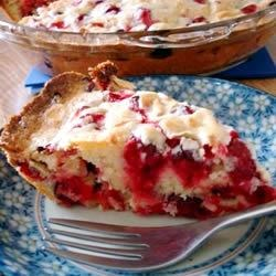 Crustless Cranberry Pie Recipe - There's flour, sugar and eggs in this cranberry-walnut filling, so it bakes up beautifully without a pie crust. It's flavored with a bit of almond extract and is the perfect mate for a scoop of vanilla or rum raisin ice cream.