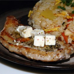 Pork Chop and Feta Skillet Recipe - These easy and delicious pork chops are seasoned with lemon juice, basil, parsley, and garlic, then seared and topped with feta cheese.