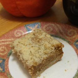 Easy Pumpkin Cheesecake Bars Recipe - Pumpkin-flavored cheesecake bars on a homemade crust studded with pecans make a delightful treat.