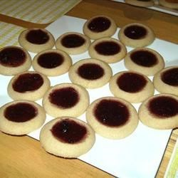 Jelly Cookies Recipe - Jam filled wells sprinkled with confectioners' sugar.