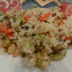 Confetti Rice with Carrot, Celery, and Almonds Recipe - This rice dish is given plenty of flavor by being baked with carrot, celery, green onion, and almonds in a mixture of butter and beef consomme.
