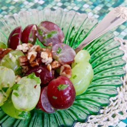 Quick 'n Easy Grape Salad with Concord Dressing Recipe - Grapes and parsley are dressed with a tangy Concord grape juice dressing in this interesting salad.