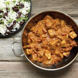 Curried Coconut Chicken Recipe and Video - Curried chicken simmered in coconut milk and tomatoes makes for a mouthwatering hint of the tropics! Goes great with rice and vegetables.