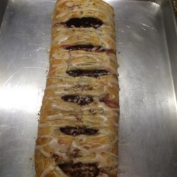 Black Walnut and Cherry Strudel Recipe - Black walnut and cherry strudel topped with a simple glaze is worth the time it takes to prepare. Slice into small pieces to serve.