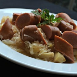 Slow Cooker Knockwurst with Sauerkraut and Apples Recipe - Far from cookin'? You'll barely have worked to make this combination knockwurst, sauerkraut, beer, and apples in a slow cooker.
