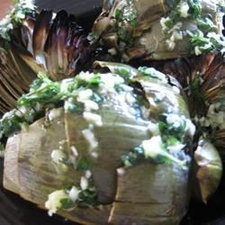 Killer Artichokes Recipe - These flavorful artichokes with their butter, garlic and shallot taste are sure to please any artichoke fan.  I especially like the smoky flavor the grill adds.