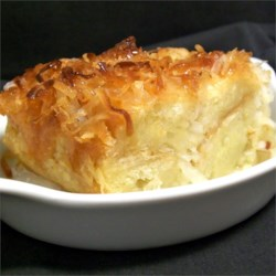 Coconut Bread Pudding Recipe - The classic bread pudding is enhanced with coconut flakes and coconut milk.