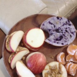 Apple Sandwich Recipe - This healthy, homemade snack is easy to prepare; all you need is an apple, some peanut butter, and a little granola.