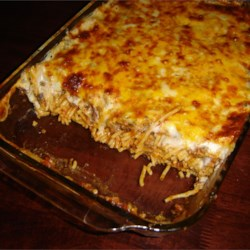 Baked Spaghetti II Recipe - A comforting baked noodle dish is your reward when you combine ground beef, chicken or turkey with onion, bell pepper and garlic with cream of mushroom soup and tomato soup. Add cooked spaghetti, top with Cheddar cheese and pop it into the oven.