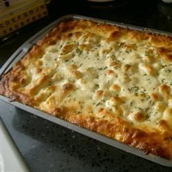 Best Ziti Ever Recipe - Ziti is layered with sausage, ricotta, mozzarella and tomato sauce, then baked until bubbling.