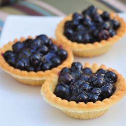 Topless Blueberry Pie Recipe - Oodles of blueberries are cooked up with sugar, water and cornstarch, until a thick and wonderful sauce has been created. Then even more blueberries are stirred in, and then this luscious berry concoction is poured into a pre-baked pastry shell and slipped into the fridge to chill. Serve this pie with lots of freshly-whipped cream.
