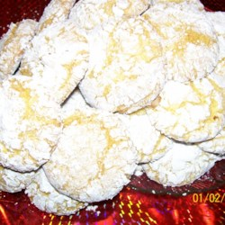 Tea Cookies II Recipe - Cake mix cookies rolled in confectioners' sugar.  M-m-mm  m-m-mmm good!  You can substitute any flavor cake mix you like in this recipe.