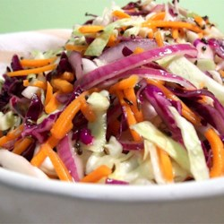 Coleslaw with Hot Caraway Vinaigrette Recipe - Crunchy red and green cabbage is tossed with red onion slivers and a hot caraway and mustard white wine vinaigrette.