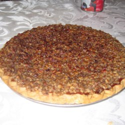 Paradise Pumpkin Pie II Recipe - This is a very rich and delicious version of the pumpkin pie. It has a cheesecake layer, a pumpkin custard layer, and is topped with caramelized pecans.  My aunt gave this recipe to me years ago, and I always get asked for the recipe.