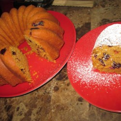 Titi's Cranberry Walnut Pumpkin Bread Cake Recipe - Pumpkin bread gets dressed up as a cake and is filled with cranberries and walnuts in this delightful Thanksgiving favorite recipe.
