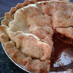 October Apple Pie Recipe - Sliced apples are tossed with sugar, flour, spices, and butter, along with some rich caramel candies. While the pie bakes, everything melts and mingle with the apples.