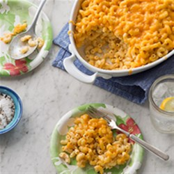 Tasty Baked Mac n Cheese Recipe - A rich macaroni and cheese casserole made with sour cream, butter, and two kinds of Cheddar cheese is ready in less than an hour but is fancy enough for a holiday dinner.