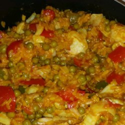 Vegan Paella Recipe - Vegan paella, made with rice, artichoke hearts, and peas, is a hearty version of the traditional Spanish-favorite.