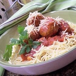 Chicken Meatballs and Spaghetti Recipe - Chicken meatballs are simmered in a homemade tomato sauce and served with spaghetti noodles.