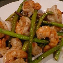 Jumbo Shrimp and Asparagus Recipe - Large shrimp sauteed with asparagus, flavored with ginger, soy sauce and sherry.