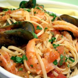 Seafood Marinara Pasta Recipe - Mussels and shrimp are simmered in a fragrant tomato sauce and served over pasta.
