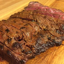 London Broil with Mouth of Fire Rub Recipe - London broil is coated with a spicy garlic rub, then grilled to your desired doneness. You can serve a crowd with this easy recipe!