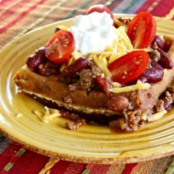 Cornbread Waffles Recipe - Cornbread mix, bacon, pepperjack cheese, and green chile peppers are cooked in the waffle iron producing a savory waffle perfect for brunch!