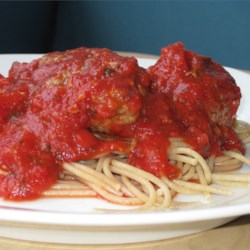 Meatball Spaghetti Sauce Recipe - Tasty seasoned meatballs simmered in a flavorful red sauce.  For a creamier sauce,  substitute milk for the water.