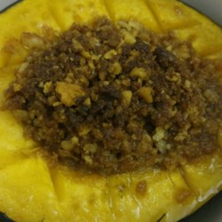 Nana's Holiday Acorn Squash Recipe - Acorn squash are filled with a mixture of crushed saltine crackers, butter, cinnamon, and brown sugar in this tasty fall side dish suitable for holiday meals.