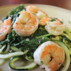 Shrimp Florentine with Zoodles Recipe and Video - Shrimp and spinach are cooked in a buttery sauce with zoodles (zucchini noodles) in this gluten-free, grain-free version of an Italian classic.