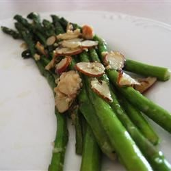 Asparagus with Sliced Almonds and Parmesan Cheese Recipe - Asparagus spears are sauteed in butter with sliced almonds and parmesan cheese. This is a terrific side with grilled salmon or turkey meatballs.