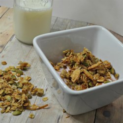 Honey-Almond Seeded Granola Recipe - Make granola at home with this recipe mixing oats, pumpkin seeds, sunflower seeds, and almonds coated in a mixture of coconut oil, honey, and maple syrup.