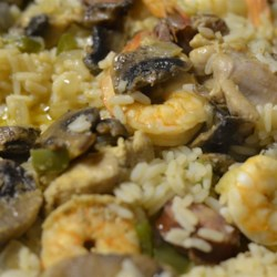 Cajun Paella Recipe - Chicken, shrimp, crawfish, andouille sausage, mushrooms, bell peppers and onion come together into a rice-based dish that no one can resist!