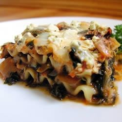 Artichoke Spinach Lasagna Recipe - This is a fabulous lasagna made with an artichoke and spinach mixture which has been cooked with vegetable broth, onions and garlic.  The mixture is layered with lasagna noodles, pasta sauce, mozzarella cheese, and topped with crumbled feta.